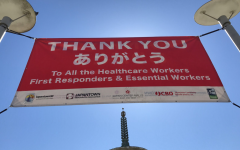 At the entrance of the Japantown Peace Plaza, a banner thanks healthcare workers, first responders, and essential workers in both English and Japanese.